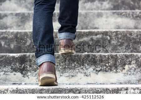 man with blue geans and  sneaker shoes in stair Сток-фото ©
