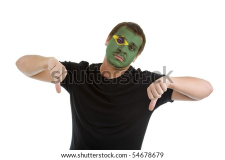 man with brazilian flag painted on his face showing two thumbs down, isolated on white background