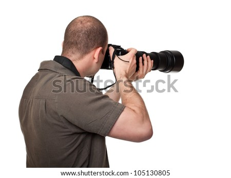 man with camera and huge lens
