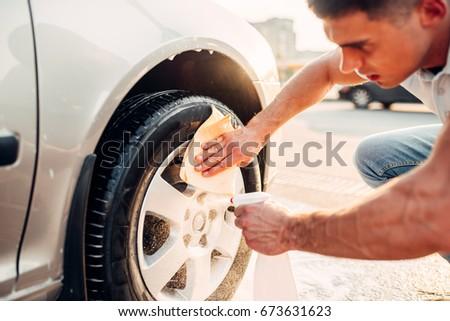 Man with car rims cleaner, carwash Stock fotó ©