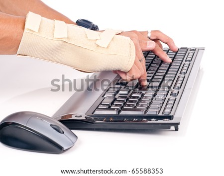 Man with Carpal Tunnel Typing