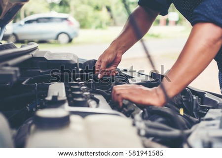 Man with checking car engine.
