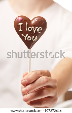 man with chocolate heart in the hands