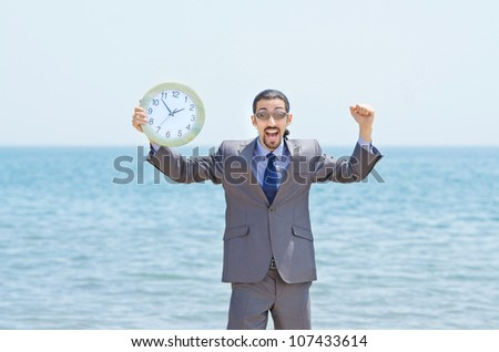 Man with clock on seaside