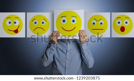 Man with different smiley faces #1239203875