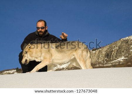 Man with dog in winter forest