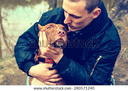 Man with dog nature dog licking man