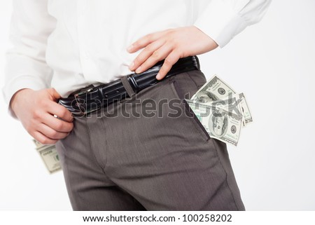 Man with dollars in pockets isolared on white