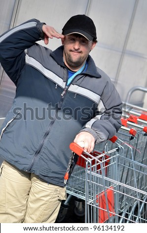 man with down syndrome with shopping cart
