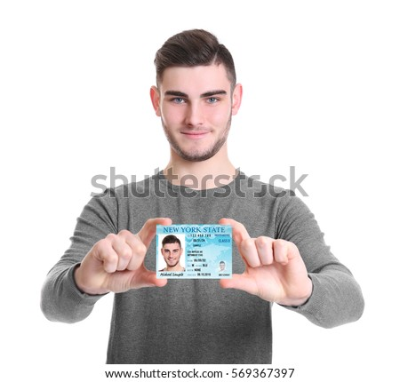 Man with driving license on white background
