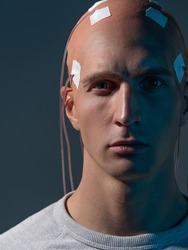 man with electrodes in his head is a futuristic concept of virtual reality and mind control. Neuro interface, contact of biological and mechanical. new kind of man, intellectual superiority