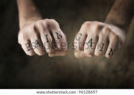 """Man with fake tattoos """"Pain"""" and """"Gain"""" on his hands, referring to the exercise motto """"No Pain, No Gain""""."""