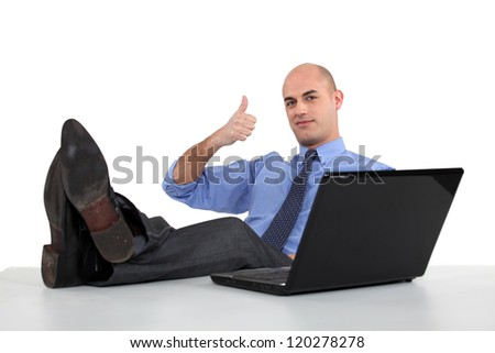 Man with feet on the table