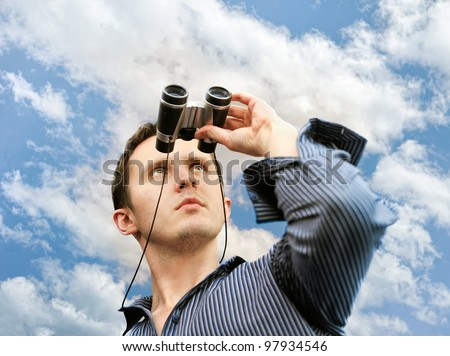 Man with field-glass in hand - stock photo
