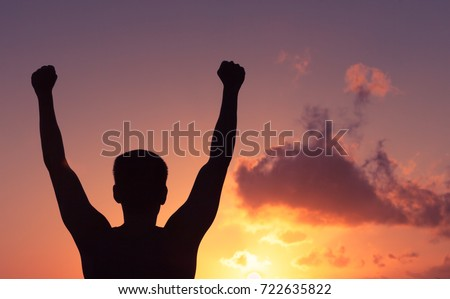 Man with fist in the air celebrating victory. .