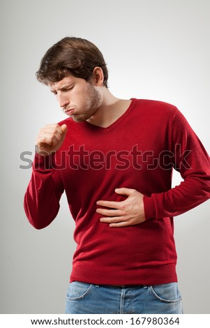 Man with flu wear in red sweater coughing
