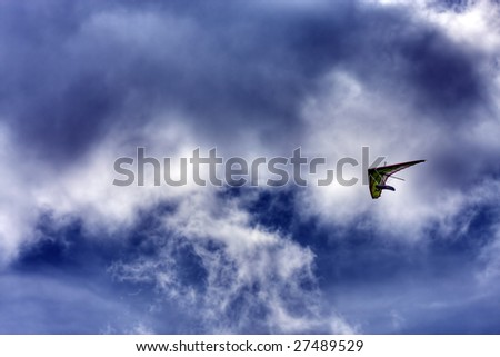 Man with flying wing on sky