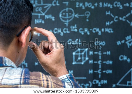 man with formula math and physic calculate board background