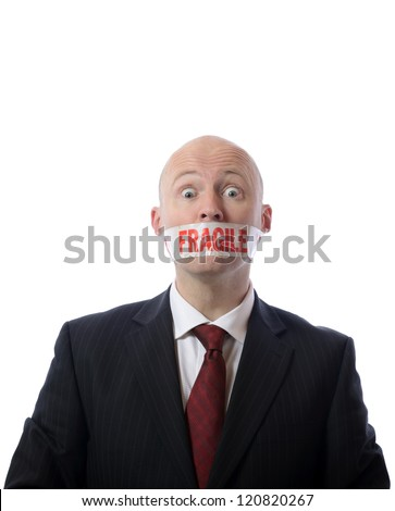 man with fragile tape over mouth concept of diplomacy or censorship isolated on white