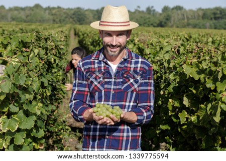 man with fresh juicy grapes #1339775594