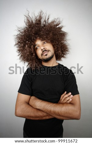 Man with funky hairstyle in a lazy mood