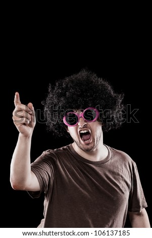 Man with funny sunglasses is grooving over black background