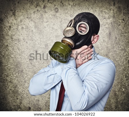 man with gas mask hold his neck