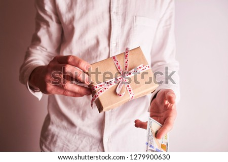 man with gift and money #1279900630