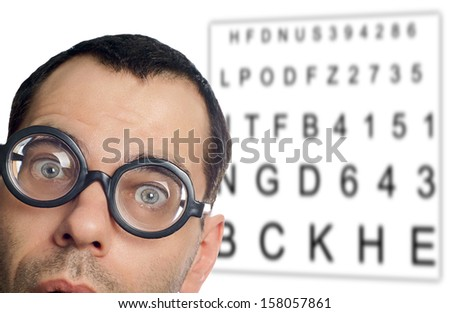 Man with glasses and eye chart / Eye Test