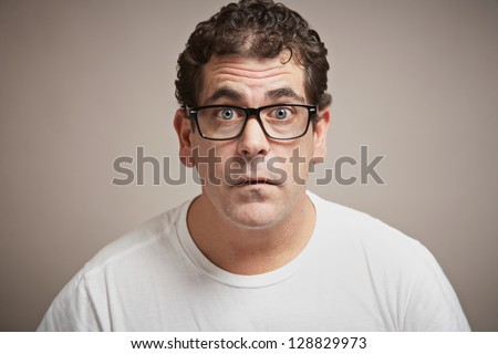 Man with glasses funny blank expression