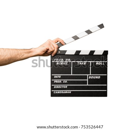 Man with glasses holding a clapperboard #753526447