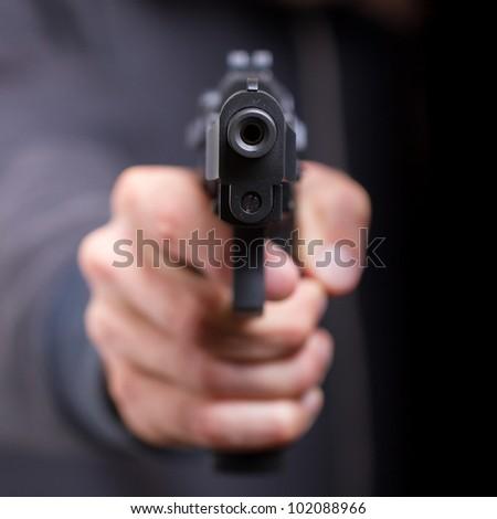 Man with gun, gangster, focus on the gun
