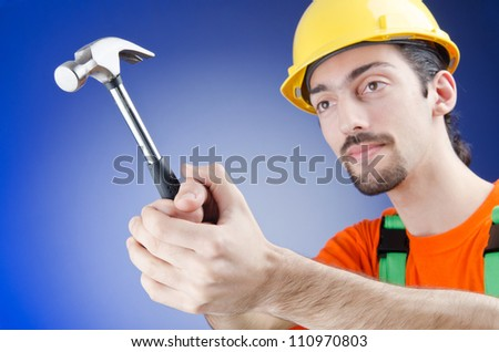Man with hammer in studio