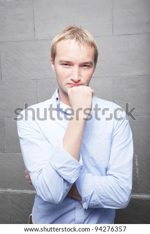 Man with hand on chin