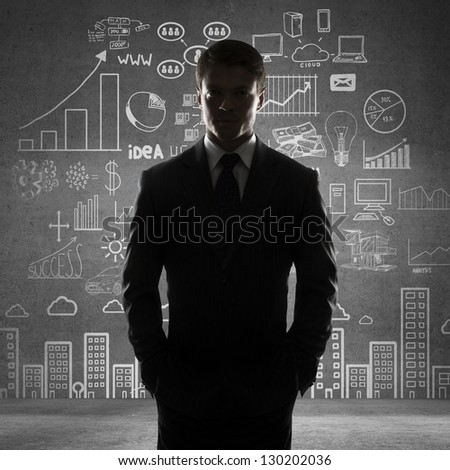 man with hands in pocket and drawing business concept