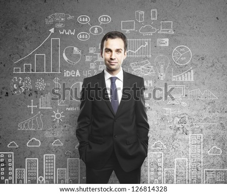 man with hands in pocket and drawing business concept on wall