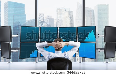 man with hands locked on back of the head sitting in front of monitors, processing data for trading, singapore at the background