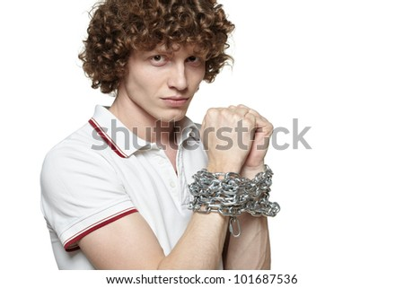 Man with hands tied by chains, isolated on white background