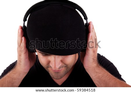 man with hat listening music in headphones, isolated on white background, studio shot