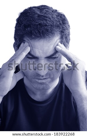 Man with headache holding his hands against the head isloated against white background with copy space. Real people concept photo of man stress, headache , depression, depressed, unhappy. (BW)