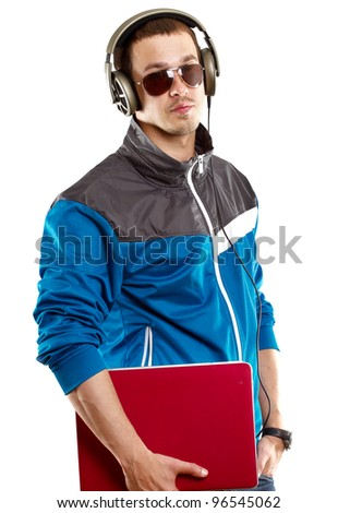 Man with headphones and laptop, listening to the music