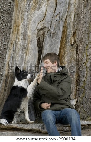 Man with his dog doing high five