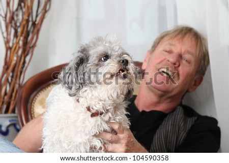 man with his dog on a sofa