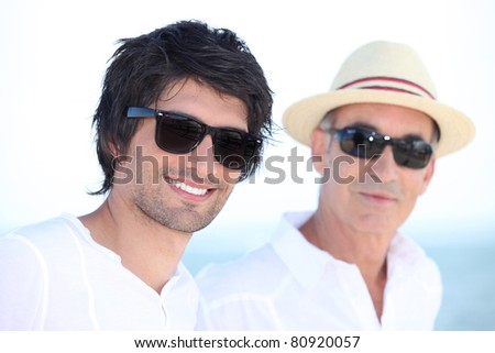 Man with his father in the sunshine