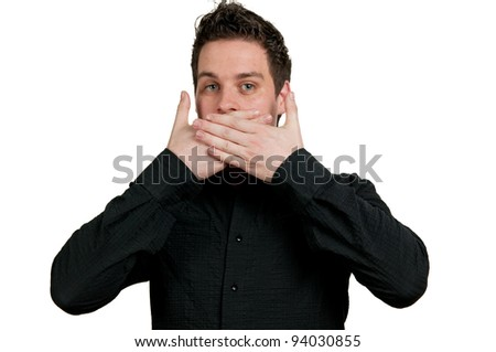 Man with his hands over his mouth and a shocked expression.
