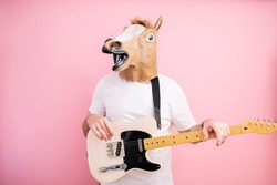 Man with horse mask with electric guitar