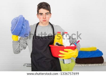 man with household and household cleaning products #1336757699