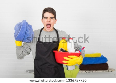man with household and household cleaning products #1336757720