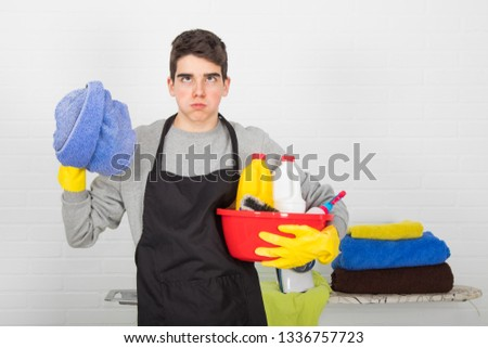 man with household and household cleaning products #1336757723