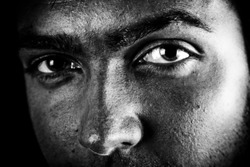 Man with intense eyes. High contrast black and white.